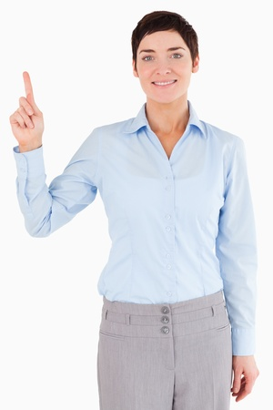 Portrait of a businesswoman pointing at copy space while looking at the camera photo