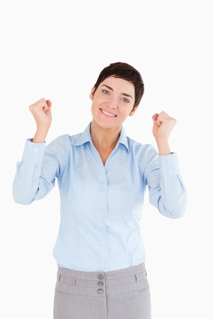 Smiling businesswoman with the fists up against a white background photo
