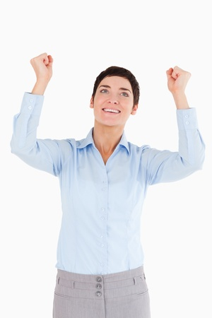Portrait of a happy businesswoman with the fists up against a white background photo