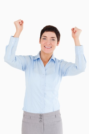 Portrait of a cheerful businesswoman with the fists up against a white background photo