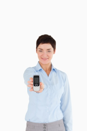 Portrait of a businesswoman showing a cellphone with the camera focus on the object Stock Photo - 11227576
