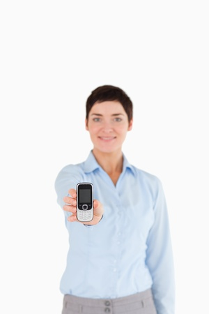 Portrait of a businesswoman showing a mobile phone against a white background Stock Photo - 11227573