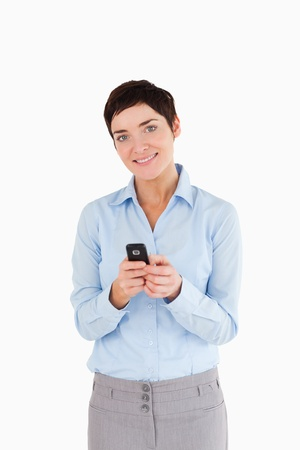Portrait of a woman sending text messages against a white background Stock Photo - 11228107
