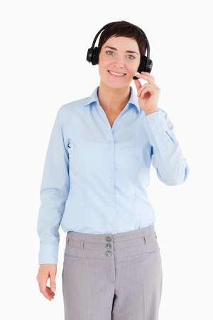 Portrait of an office worker with a headset against a white background photo