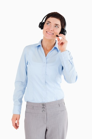 Portrait of a smiling office worker with a headset against a white background photo
