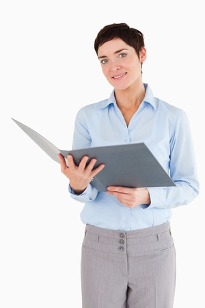 Portrait of a businesswoman holding a binder against a white background photo