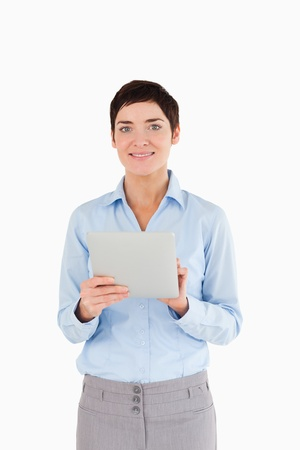 Portrait of a businesswoman holding a document against a white background photo
