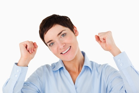 Close up of a cheerful businesswoman against a white background photo