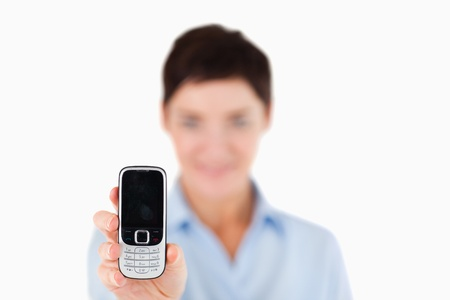 Close up of a woman showing a cellphone with the camera focus on the object Stock Photo - 11227916