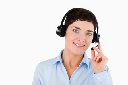 Close up of a secretary using a headset against a white background photo