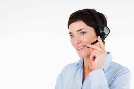 Close up of a office worker using a headset against a white background photo