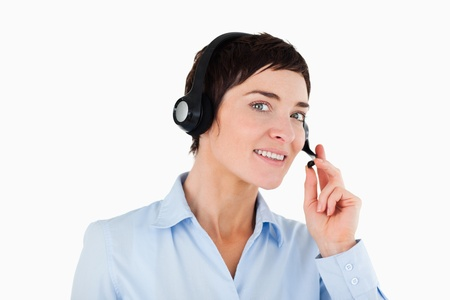 Close up of a female worker using a headset against a white background photo