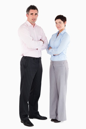 Office workers standing up against a white background photo