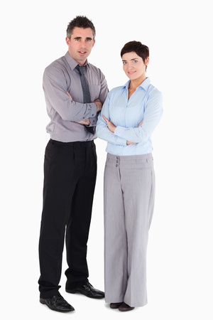good looking woman: Coworkers standing up against a white background