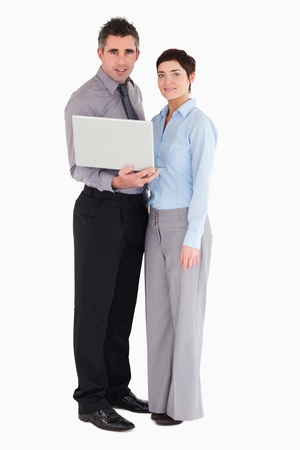 Office workers holding a laptop against a white background photo