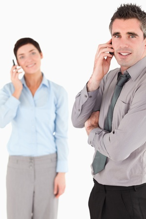 Portrait of a business people making a phone call against a white background photo