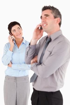 Portrait of office workers making a phone call against a white background photo