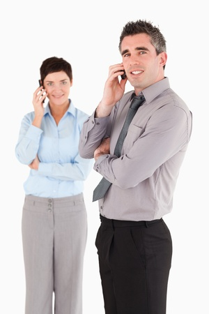 Portrait of coworkers making a phone call against a white background photo