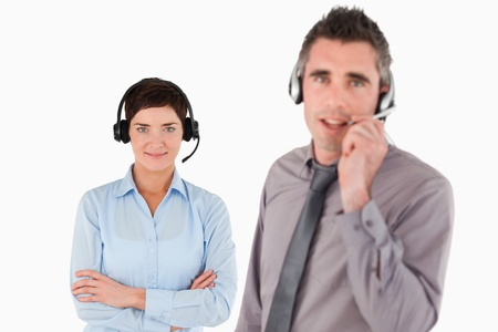 Isolated managers using headsets against a background Stock Photo - 11226271
