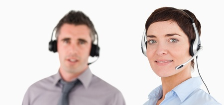 telephone saleswoman: Close up of managers using headsets against a white background