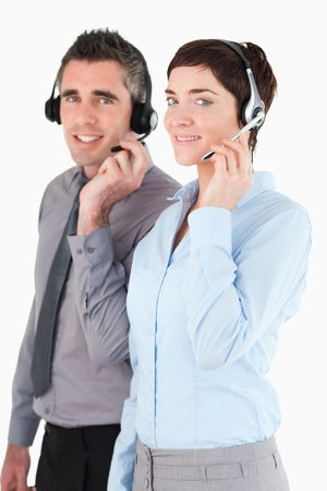 Portrait of operators speaking through headsets against a white background photo