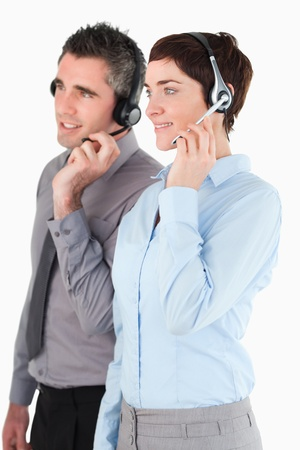Portrait of operators using headsets against a white background photo