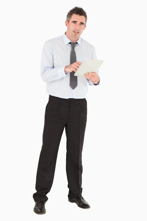 Businessman holding a tablet computer against a white background photo