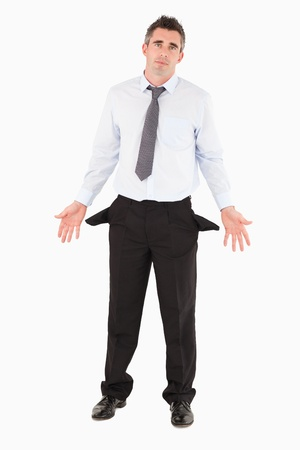 Portrait of a broken businessman against a white background photo