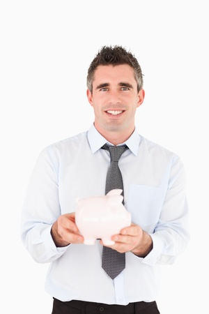 Man holding a piggy bank against a white background photo