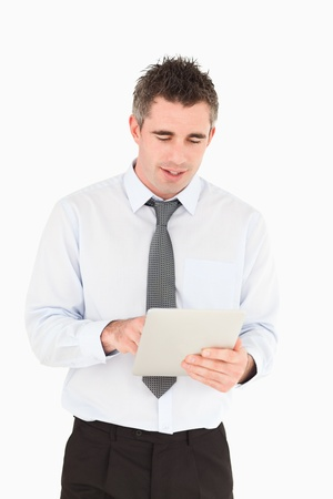 Portrait of a businessman using a tablet computer against a white background photo