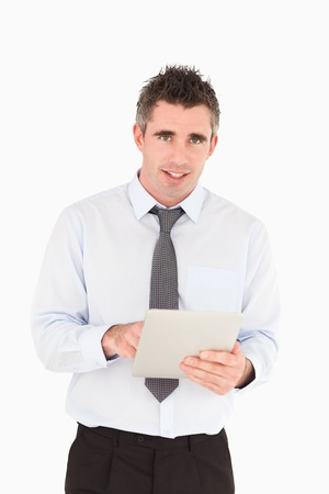 Portrait of a businessman with a tablet computer against a white background photo