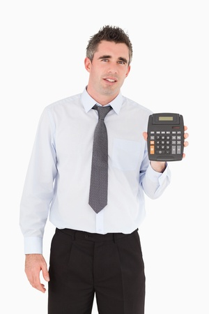 Accountant showing a calculator against a white background photo