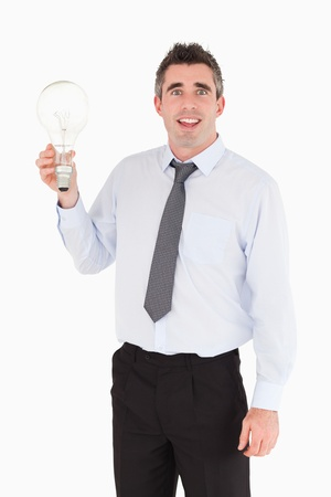 Man holding a light bulb against a white background photo