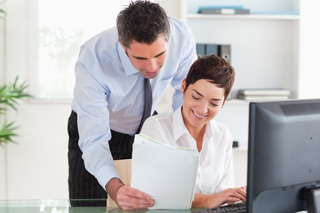 Businessman showing document to his colleague in an office Stock Photo - 11190962