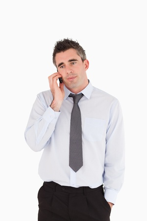 Portrait of a businessman making a phone call against a white background photo