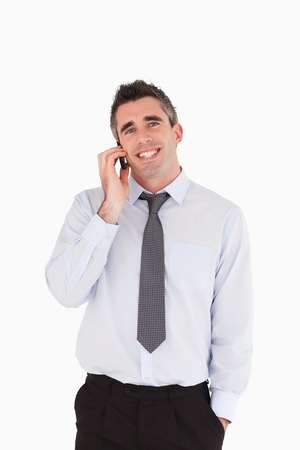 Portrait of a man making a phone call against a white background photo