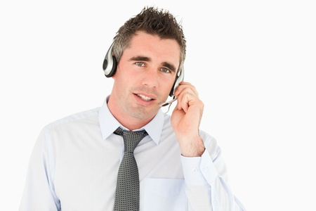 Operator speaking through a headset against a white background photo