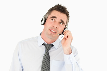 Handsome operator speaking through a headset against a white background photo
