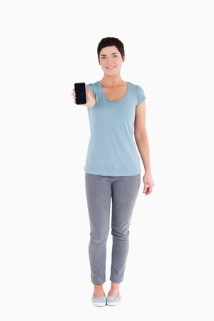 Woman showing a smartphone against a white background Stock Photo - 11227567
