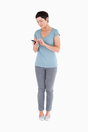 Woman using a smartphone against a white background Stock Photo - 11227665