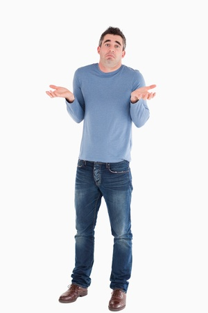 Clueless man posing against a white background photo