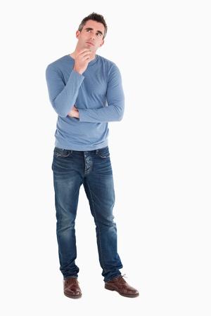 men casual: Doubtful man posing