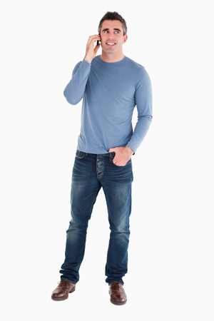 Happy man answering the phone against a white background photo