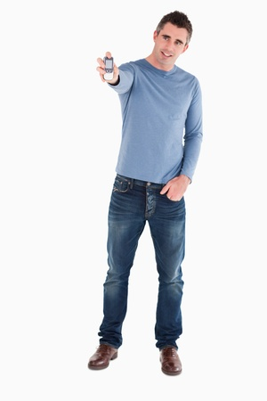 Handsome man showing his mobile phone against a white background Stock Photo - 11227886