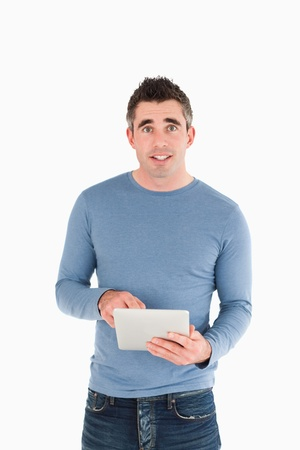 Portrait of a man holding a tablet computer against a white background photo