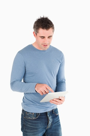 Portrait of a man working with a tablet computer against a white background photo
