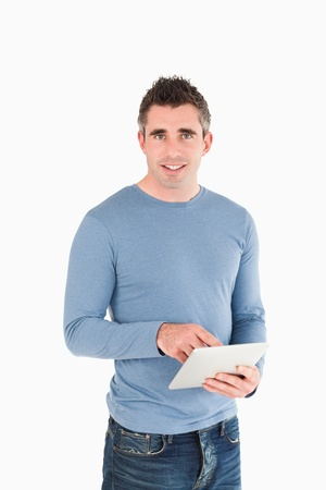 Portrait of a man with a tablet computer against a white background photo