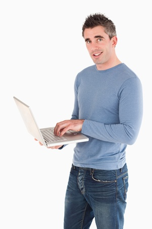 Man using a laptop against a white background photo