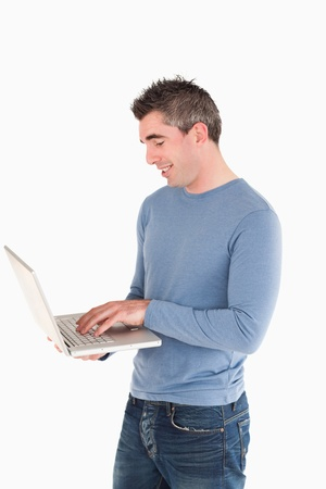 Man working with a laptop against a white background photo
