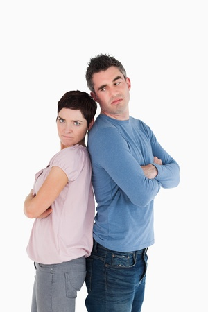 Couple angry at each other standing back to back photo